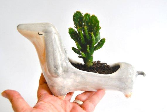 """Ceramic **Dachsund planter**, $58.51, from [Etsy](https://fave.co/2zeYVvR
