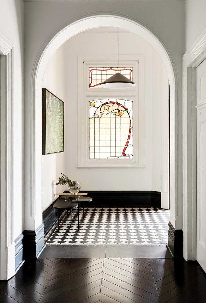 The entry to this Edwardian home that has been updated by architecture firm BayleyWard opens into an inviting reception vestibule with a chequerboard floor and decorative leadlight windows. *Photograph*: Eve Wilson | *Styling*: Claire Larritt-Evans. From *Belle* May 2018.
