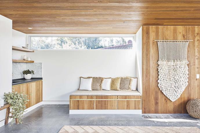 """**Studio** The timber ceiling ties in with timber cabinetry to add warmth to the space against a [concrete floor](https://www.homestolove.com.au/a-guide-to-concrete-flooring-16194