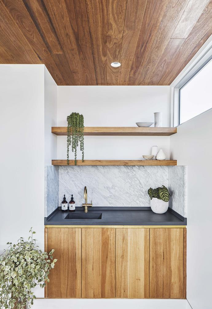 **Kitchen** The brass inlay details on the cabinetry and Reece tumbled brass tapware add a little punch to the black concrete benchtop by Slabshapers.