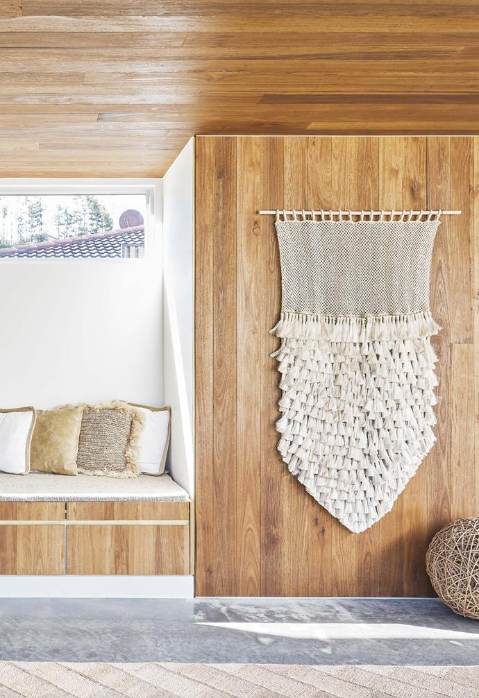 **Studio**  A wall hanging from The Dharma Door contributes to the relaxed coastal mood.
