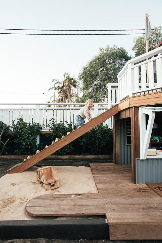 "[Kyal and Kara created the ultimate cubby](https://www.homestolove.com.au/kyal-and-kara-cubby-house-19280|target=""_blank"") for their kids, complete with a sandpit, porthole and shop."
