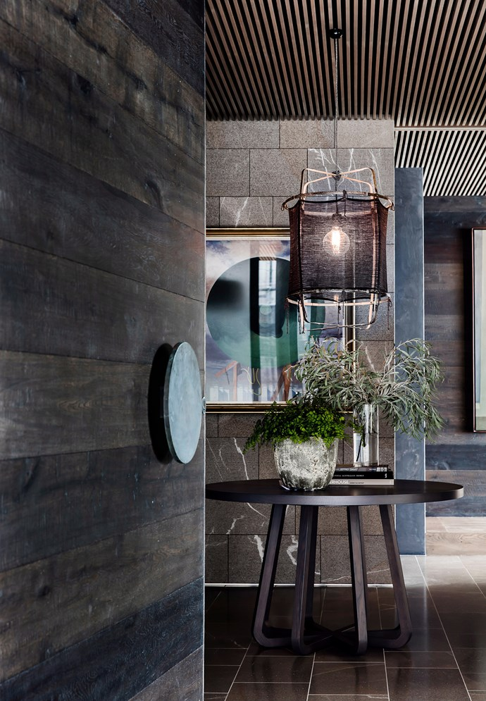 Set the scene at the entrance of your home with a striking, dimmable pendant light. *Photo: Maree Homer / bauersyndication.com.au*