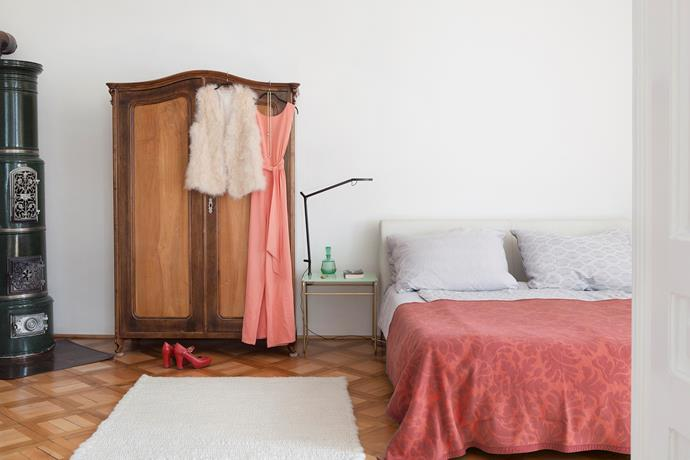 The spacious bedroom contains more of Nina's creations: the Tilda side table and Fat Sheep wool rug. The wardrobe is vintage like most of the clothes inside.