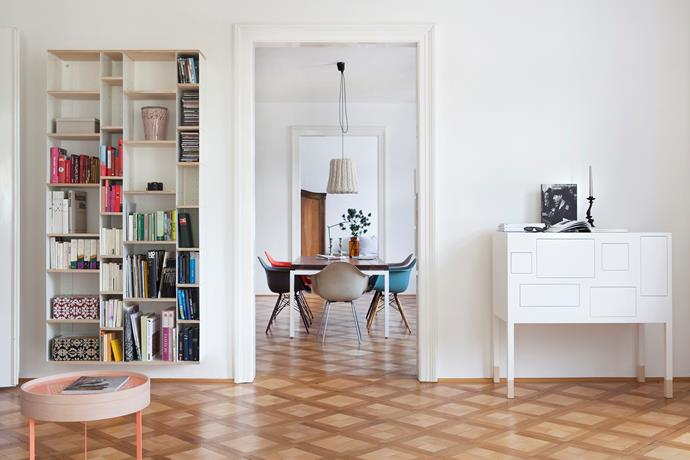 A metal and wood bookcase houses Nina's collection of art and design books. A light touch opens the drawers on the Mrs Robinson cabinet from Pudelskern, revealing brightly patterned containers inside.