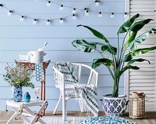 A Hamptons style outdoor setting with fairy lights