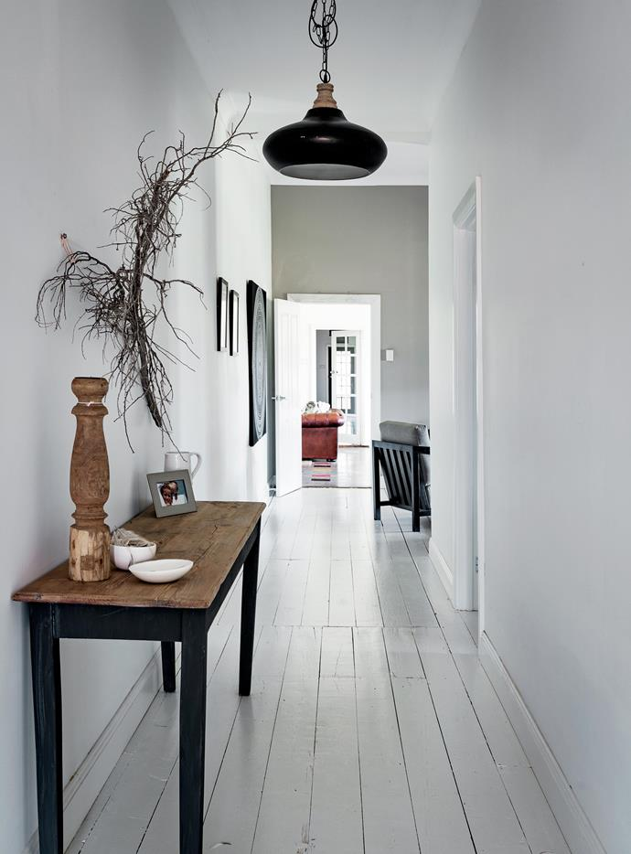 The walls of the hallway are painted in Wattyl Freesia, while the floor is Porter's Paints Perfect Floor Paint in K2. The house's exterior is clad in Weathertex and painted in Dulux Domino.