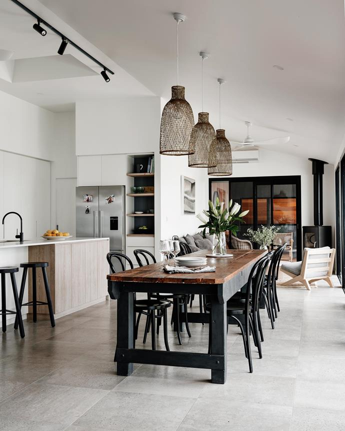 "The former draftsman's table in the kitchen was recused from the workshed. Thonet chairs and the Connect bar stools are from [kin](https://www.kindesignco.com/|target=""_blank""