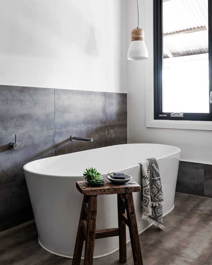 "Zanna has incorporated earthy materials and textures into the bathroom. The freestanding bathtub is [Reece](https://www.reece.com.au/|target=""_blank""