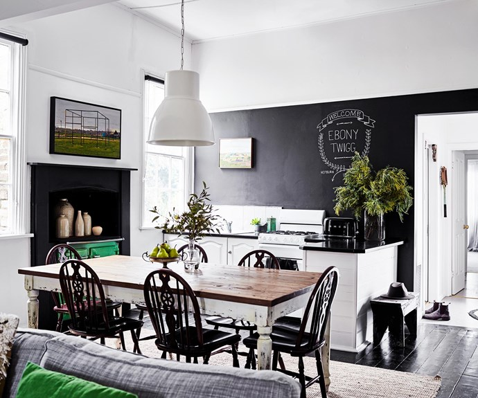 A pendant light from IKEA hangs in the dining area, where the property's name Ebony Twigg — designed by Kerrie's son, Jackson — is proudly displayed. Her grandfather's old football trophy has been turned into a fruit stand.