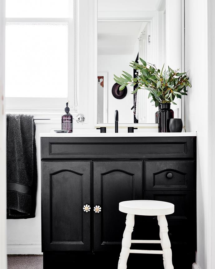 "In the bathroom, the vanity is painted in Dulux Domino with black tapware from [Bunnings](https://www.bunnings.com.au/|target=""_blank""