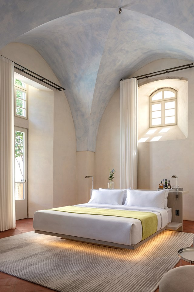 "<p>***THE JAFFA HOTEL, ISRAEL***<p> <p>Minimalism is the order of the day here at [The Jaffa Hotel](https://www.homestolove.com.au/the-jaffa-hotel-hospital-conversion-19300|target=""_blank"") in Israel, where each bedroom has been styled to allow the former hospital's architectural features shine. Custom furniture was built for each room, which vary in shape and size. Floating beds and six-metre-high ceilings will certainly elevate your spirit.<p> <p>**For bookings and information, visit [The Jaffa Hotel](https://www.thejaffahotel.com/