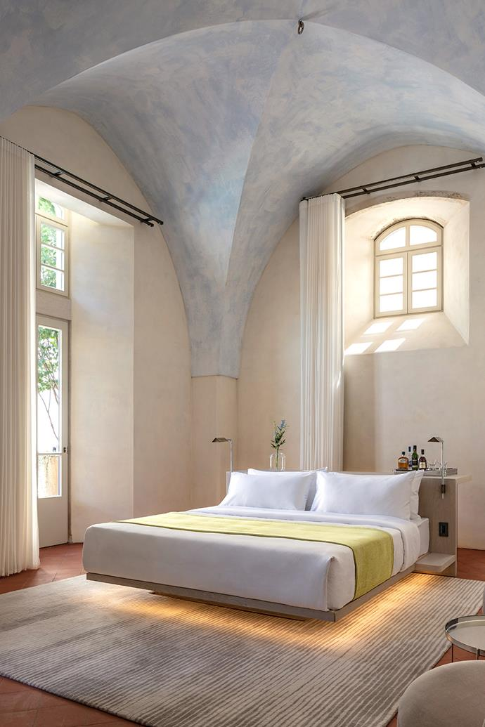 Each guestroom is unique, so custom furniture was designed to fit. Floating bed by John Pawson.
