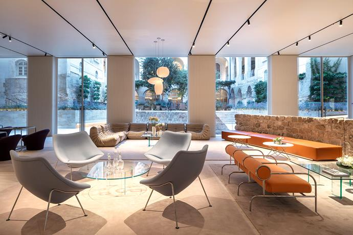 Part of a 13th-century bastion wall was uncovered in the courtyard and is now a feature in the lobby. The chairs are by Shiro Kuramata.