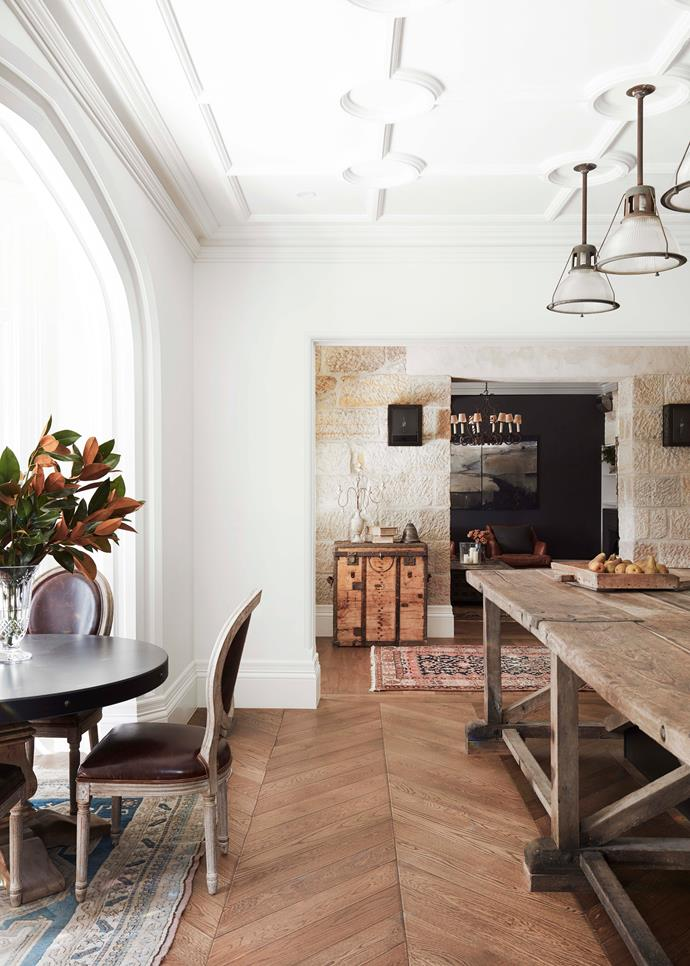 In the kitchen/dining area, brass studded vintage trunk from Le Marché Antiques. Vintage wall sconces from Sally Beresford. Antique iron chandelier (in sitting room) from The Country Trader.