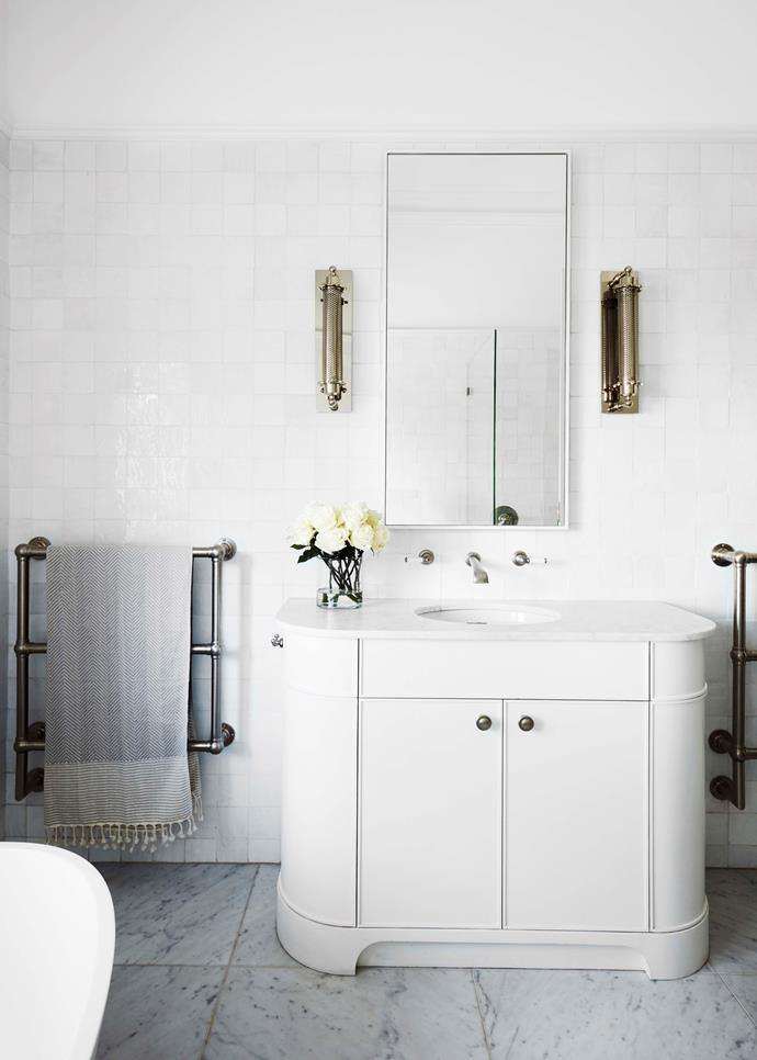 Carrara marble floor tiles from Inigo Jones & Co. Hawthorn Hill heated towel rails from The English Tapware Company.