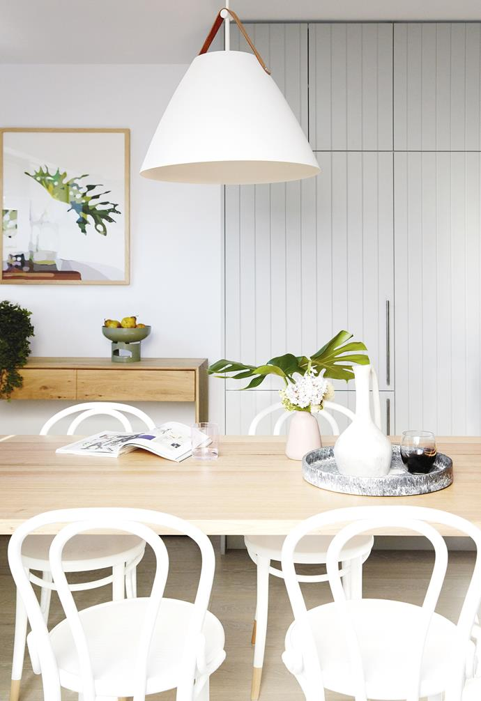 "**Dining** A brushed steel pendant with leather strap from [Lights Lights Lights](https://www.lightslightslights.com.au/|target=""_blank""
