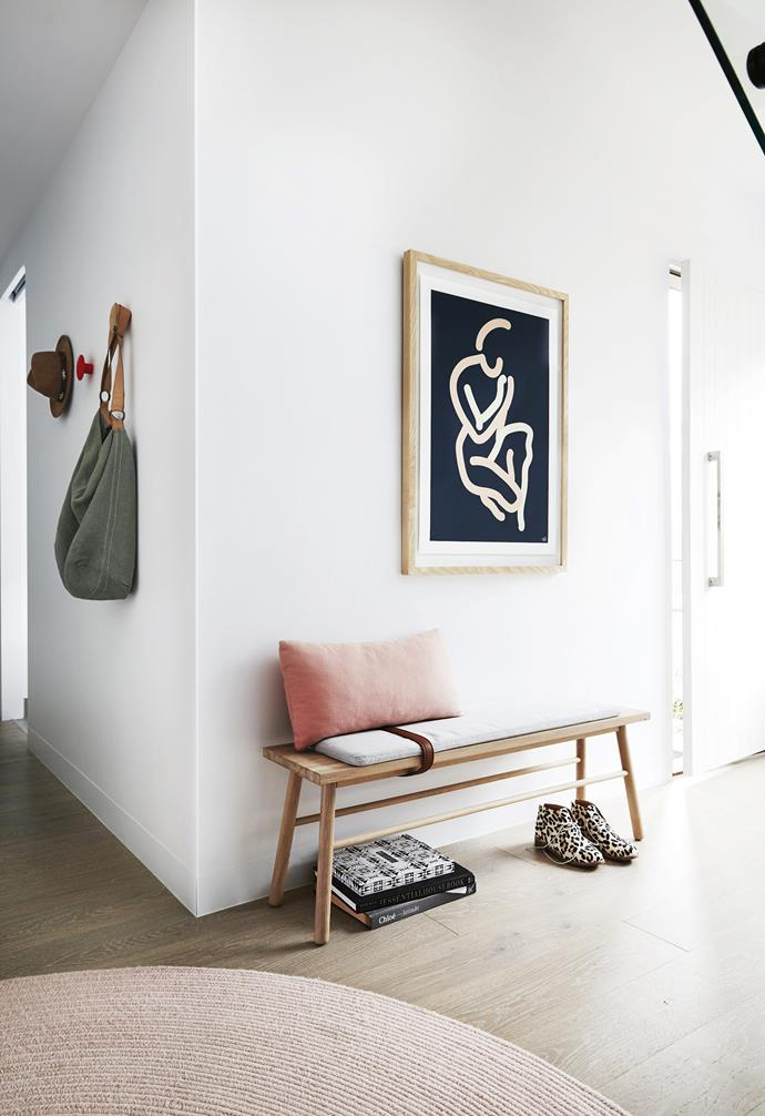 "**Entry hallway** The sleek, Nordic-inspired Bloomingville bench with unique leather strap detail creates a chic sitting spot in the entrance hallway. A graphic print by Caroline Walls completes the picture. Bloomingville bench, [Clickon Furniture](https://www.clickonfurniture.com.au/|target=""_blank""