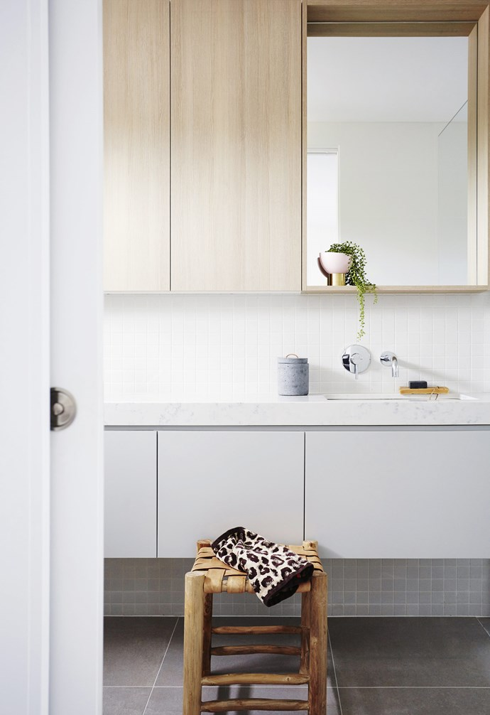 "**Bathroom** The light, bright feel extends to the bathroom, where sleek cupboards provide ample storage and hard-wearing yet luxurious surfaces contribute to the minimalist vibe. Stool, [Rigby's Homewares](https://rigbys.com.au/|target=""_blank""