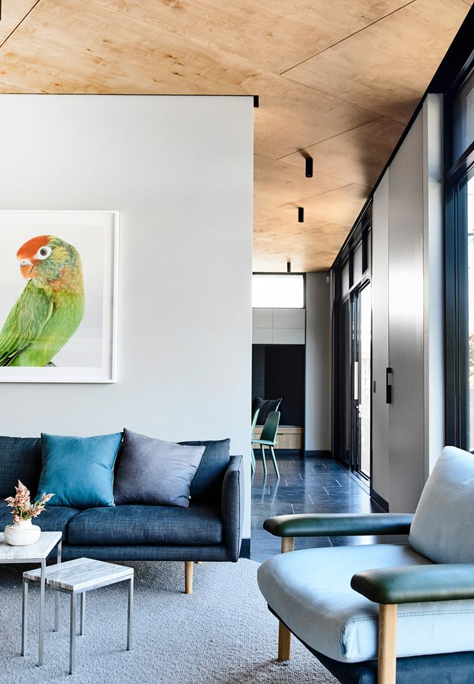 The home's colour scheme - featuring a mix of cool greys, timber tones and leafy greens - was inspired by the surrounding neighbourhood.