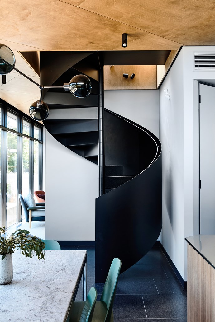 A spiral staircase was deliberately chosen by the architects to maximise space and become a feature of the compact home.