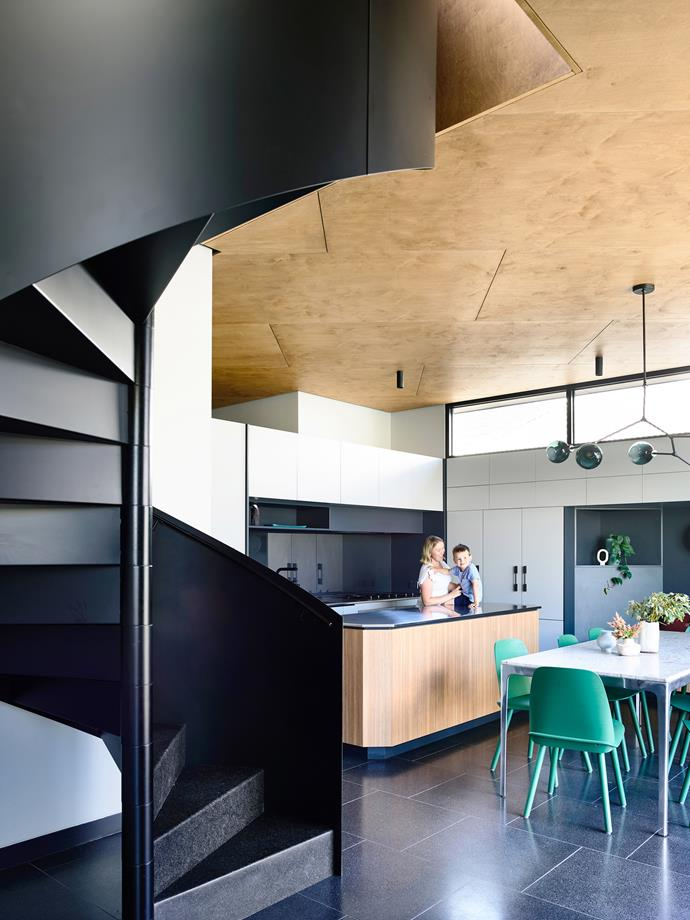 The kitchen was oriented to the east-facing deck, and is the hub of the home. Ceiling, Maxi Plywood sheets. Benchtop, brushed stainless steel.