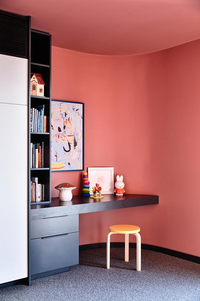 """All the bedrooms have slightly different built-in features. Madeleine's room features a study nook made from charcoal [laminate by Laminex](https://www.homestolove.com.au/vintage-materials-reimagined-4425 target=""""_blank"""")."""