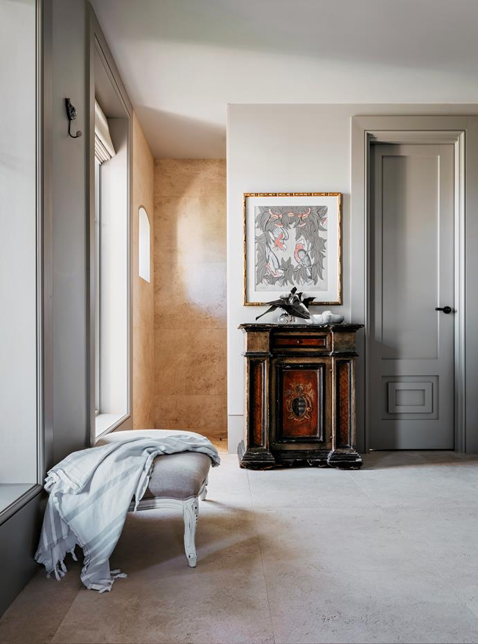 In the main ensuite, a Bruce Goold collage hangs above a Florentine cabinet.