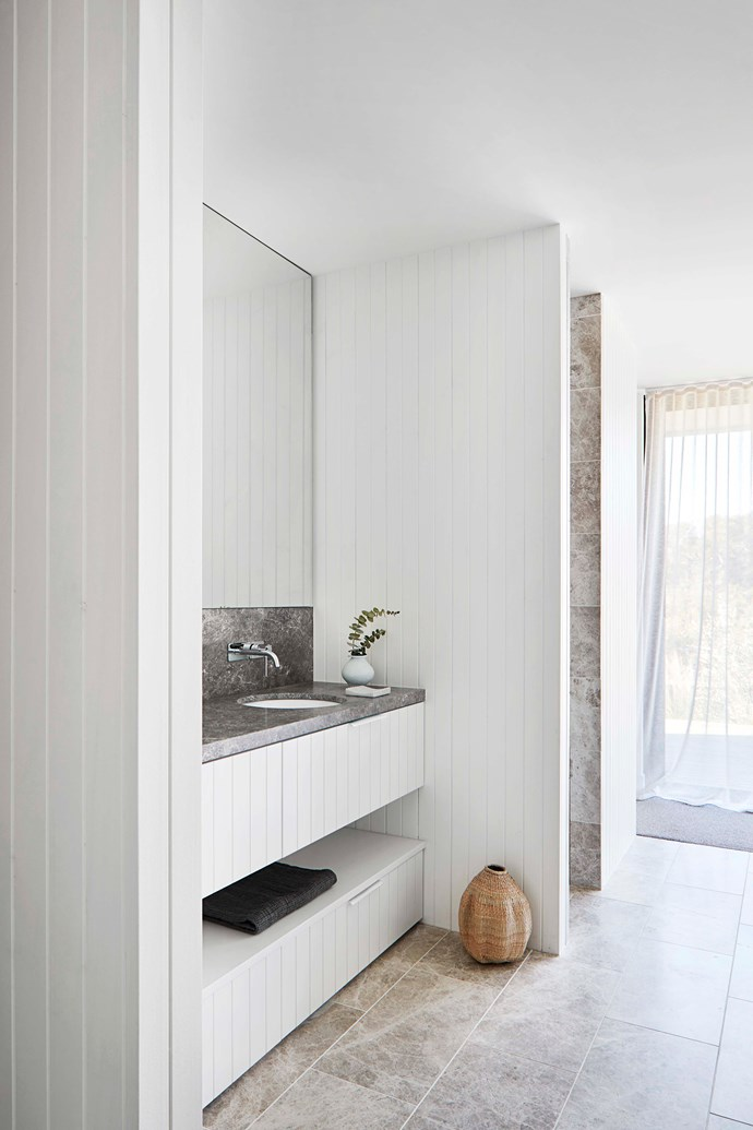 The bathroom features a stone bench with boards in Dulux 'Natural White.'