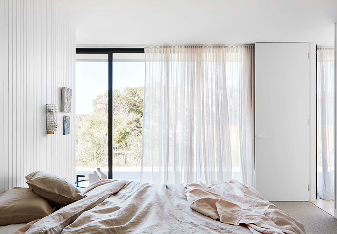 "The main bedroom features linen from Cultiver and a vintage Barovier & Toso sconce from [The Vault](https://thevaultsydney.com/collections/all|target=""_blank""