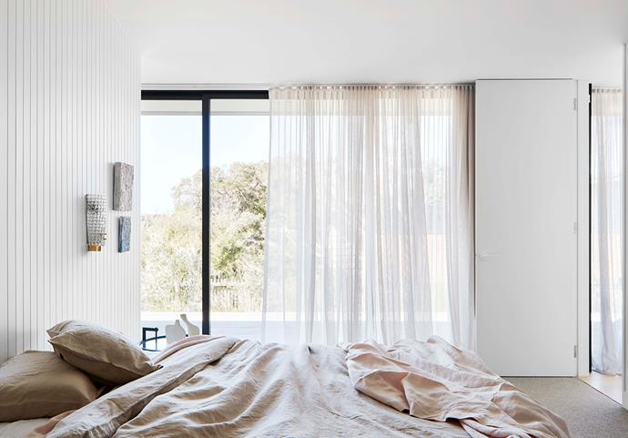 """The main bedroom features linen from Cultiver and a vintage Barovier & Toso sconce from [The Vault](https://thevaultsydney.com/collections/all