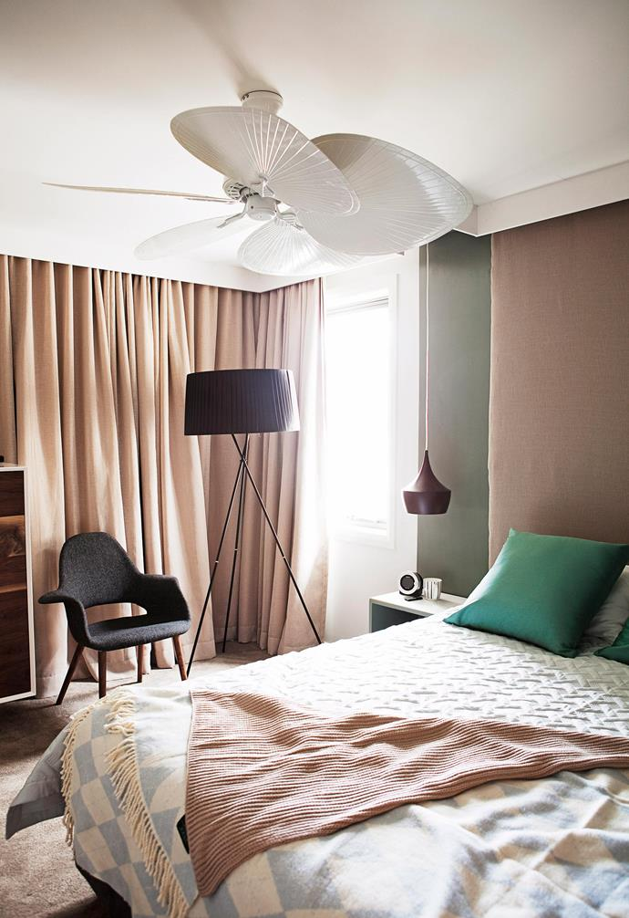 **Sculptural scene** The dramatic shape of this fan adds dimension to the dreamy bedroom setting. *Photography: Chris Warnes/bauersyndication.com.au*.