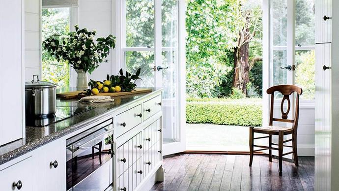 Elegant white panelled cabinetry nods to Hamptons style. *Photography: Brigid Arnott*