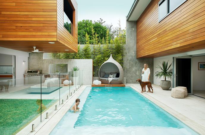 In keeping with the couple's healthy-home ethos, they opted for a MagnaPool, which uses minerals such as magnesium and a glass filtration system instead of chlorine to keep the water clean. The structure at right is a pool house with guest accommodation above.