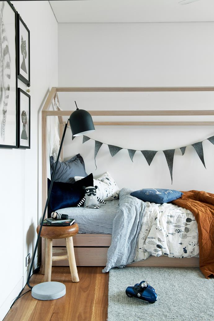 Oliver's house bed, built by David, incorporates a trundle for sleepovers. Stool and floor lamp, Empire Homewares. Bunting sourced from Etsy.