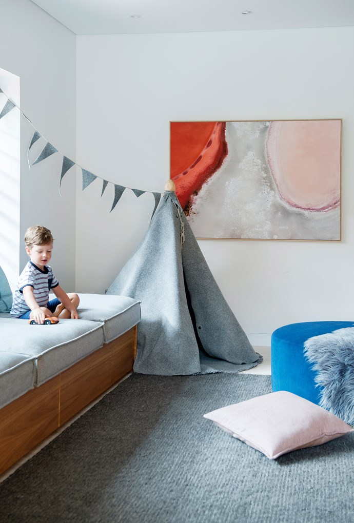 There's a place for everything in the playroom, right down to a dog bed for Rupert, which is pulled out of the window seat when required. The handmade felt and wood teepee, sourced from Etsy, gives Oliver hours of fun. Artwork by Jody D'Arcy.