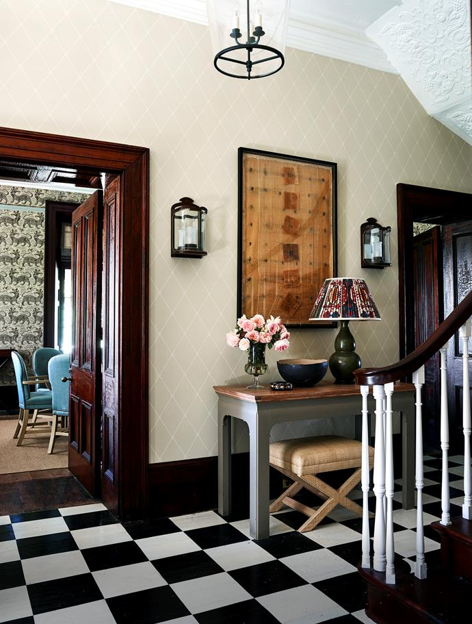 Entrance hall wallpapered in Cole & Son 'Large Georgian Rope Trellis' with floors painted by Mullany & Co.