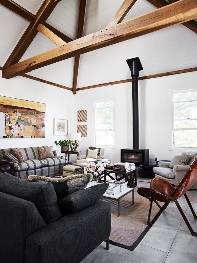 The living room's exposed frame is by Chris Nance of Traditional Timber Frames in Marulan. Leather chair from Ralph Lauren.