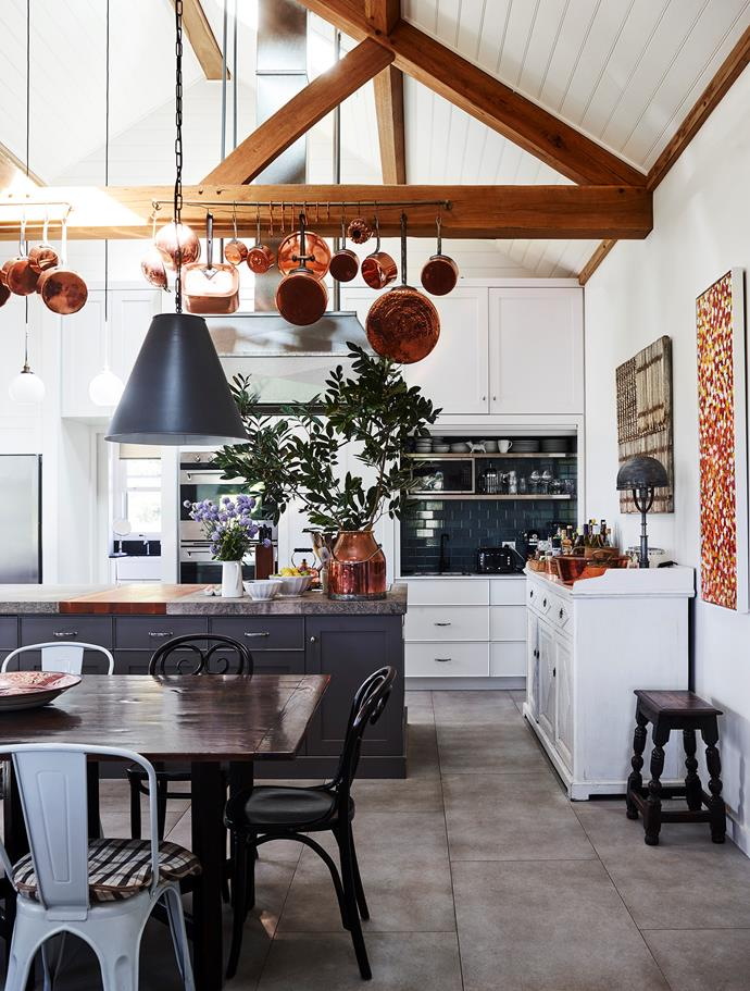 Joinery by Kirrawee Kitchens in Taubmans 'Alpaca White' with island bench in Resene 'Tapa' topped with Elvira marble from Bisanna Tiles. Vintage copper pots and milk churn with hanging tole shade from Restoration Hardware.