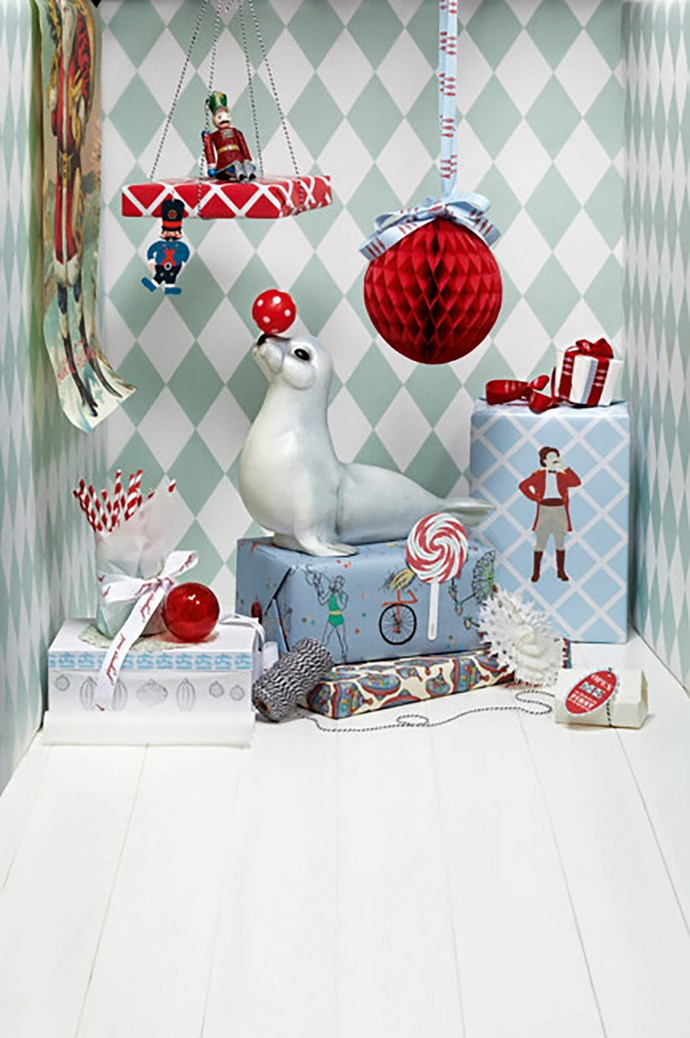**Circus** - There's no denying that red is the quintessential colour of Christmas. For a twist on traditional Christmas wrapping, pair red hues with baby blues for a stack of gifts with a circus theme. This look is all about red-and-white stripes and traditional motifs like nutcrackers, bicycles and spinning tops.