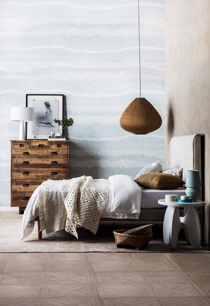 **Moody palette** The earthy colour of this pendant light echoes the tones of the dresser and flooring. *Photography: Maree Homer/bauersyndication.com.au*.