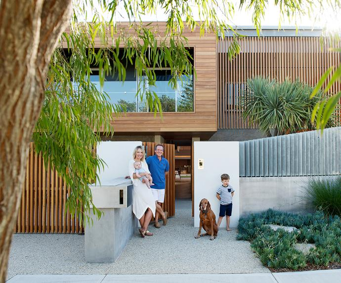 Family standing in front of their eco-consciouse home in Perth