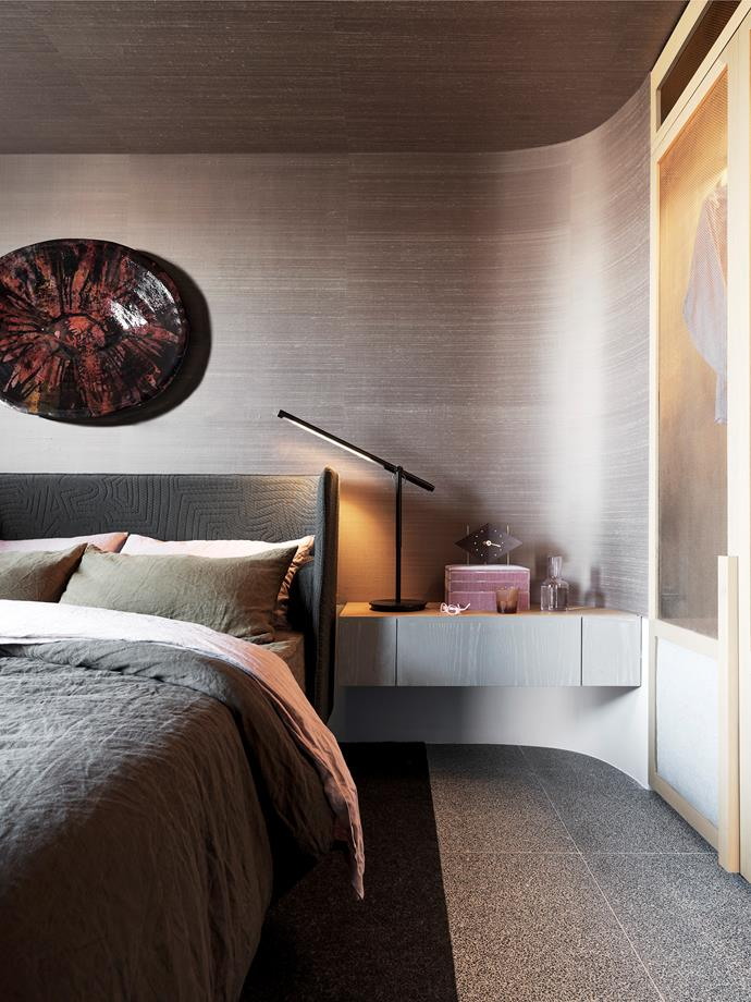 NAU 'Aran' bed by Adam Goodrum from Cult with linen by Society and Cultiver. 'Penang' silk wallpaper in Tamarind from Instyle.