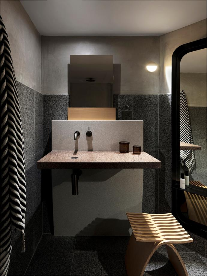 Bathroom fixtures by Astra Walker, custom vanity, wall sconce from Koda Lighting and stool from Living Edge.