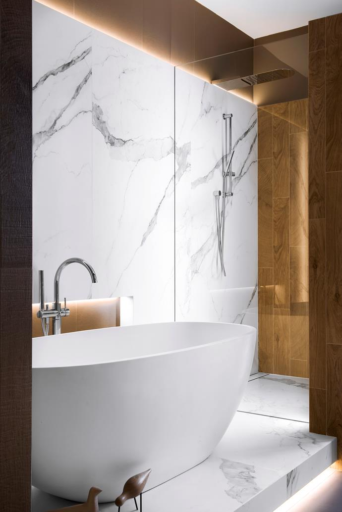 Positioning the bath on a marble platform elevates its status to star of the bathroom.