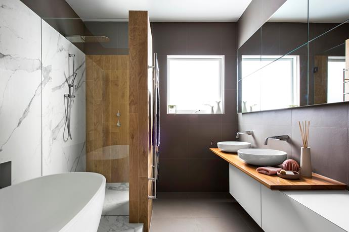 Timber-look tiles create texture and warmth and complement the timber on the vanity top.