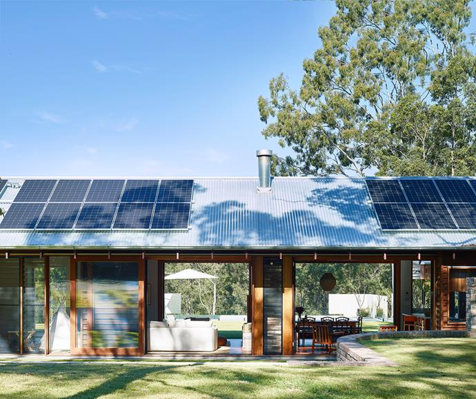 The exterior of the house features untreated ironbark weatherboards set beneath a Zincalume roof topped with a 10kW photovoltaic system, which powers the entire off-the-grid property.