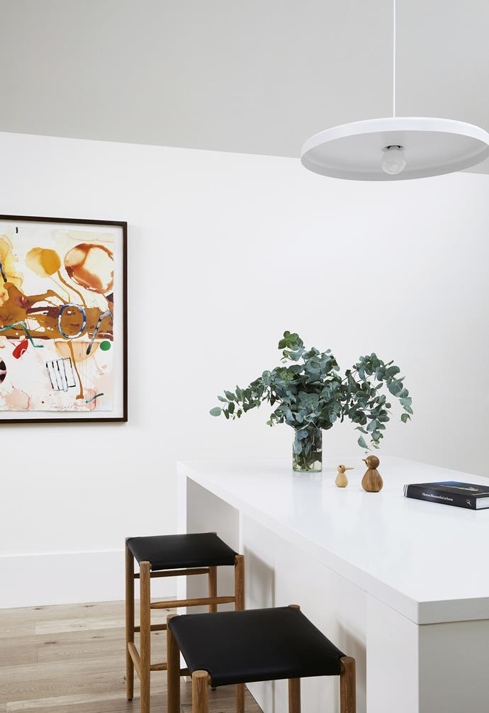 """**Eat-in option** Interior designer Sarah chose bar stools from Luke Furniture to allow for casual dining at the island bench. *Artwork by [Graham Fransella](http://grahamfransella.com.au/ target=""""_blank"""" rel=""""nofollow"""")*."""