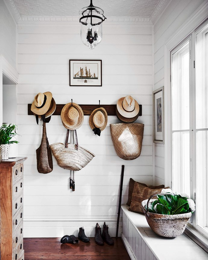 Each family member has a storage hook in the mud room. | *Photography: Lisa Cohen | Styling: Tess Newman-Morris*