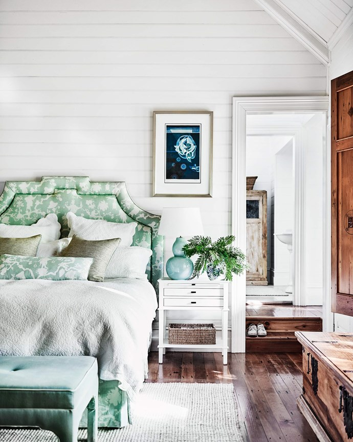 """The master bedroom has an upholstered bedhead, cushion and valance in Schumacher Shantung Silhouette linen in Mineral from [Grant Dorman Interior Products](https://www.grantdorman.com.au/